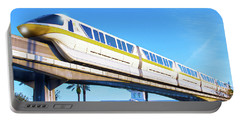 Portable Battery Charger featuring the photograph Walt Disney World Monorail by Mark Andrew Thomas