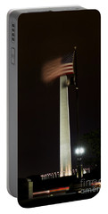 Portable Battery Charger featuring the photograph Washington Monument At Night With Flag by Angela DeFrias