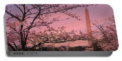 Portable Battery Charger featuring the photograph Washington Monument Cherry Blossom Festival by Shelley Neff