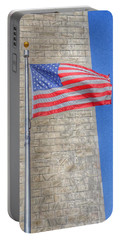 Portable Battery Charger featuring the photograph Washington Monument With The American Flag by Marianna Mills