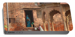 Portable Battery Charger featuring the photograph Water Delivery In Vrindavan by Jean luc Comperat