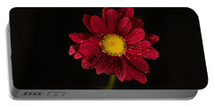 Portable Battery Charger featuring the photograph Water Drops On A Flower by Jeff Swan