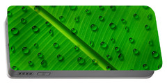 Water Drops On Palm Leaf Portable Battery Charger by Georgeta Blanaru