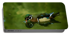 Male Wood Duck Water Reflections Portable Battery Charger by Claudia Ellis
