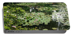 Portable Battery Charger featuring the photograph Waterlilies At Monet's Gardens Giverny by Therese Alcorn