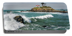 Portable Battery Charger featuring the photograph Wave Break And The Lighthouse by Greg Nyquist