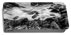 Portable Battery Charger featuring the photograph Waves Against A Rocky Shore In Bw by Doug Camara