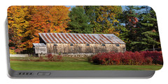 Portable Battery Charger featuring the photograph Weathered Barn With Rusty Tin Roof by Betty Denise