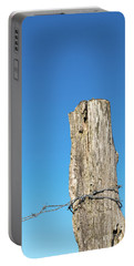 Portable Battery Charger featuring the photograph Weathered Old Post With Barbwire by Kennerth and Birgitta Kullman