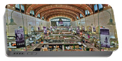 Portable Battery Charger featuring the photograph West 25th Street Market by Frozen in Time Fine Art Photography