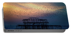 Portable Battery Charger featuring the photograph West Pier Murmuration by Chris Lord