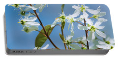Portable Battery Charger featuring the photograph White Blossom by Cristina Stefan