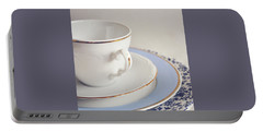 Portable Battery Charger featuring the photograph White China Cup, Saucer And Plates by Lyn Randle