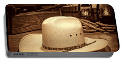 White Cowboy Hat In A Barn Portable Battery Charger