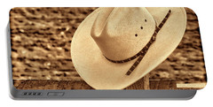 White Cowboy Hat On Fence Portable Battery Charger