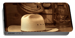 White Cowboy Hat On Workbench Portable Battery Charger