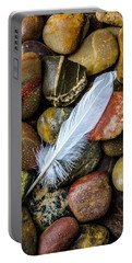 White Feather On River Stones Portable Battery Charger