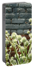 White Flowers And Bricks Portable Battery Charger by Susan Lafleur