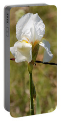 Portable Battery Charger featuring the photograph White Iris And Barbed Wire by Sheila Brown