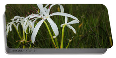 White Lilies In Bloom Portable Battery Charger by Christopher L Thomley