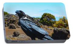 Portable Battery Charger featuring the photograph White-necked Raven Overlooking Mount Meru by Jeff at JSJ Photography