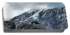 Portable Battery Charger featuring the photograph White-necked Raven Pair Under Kilimanjaro Summit Glacier by Jeff at JSJ Photography