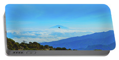 Portable Battery Charger featuring the photograph White-necked Raven Soaring Above Mount Kilimanjaro With Mount Meru by Jeff at JSJ Photography