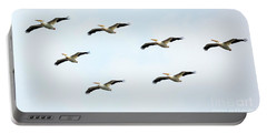 Portable Battery Charger featuring the photograph White Pelican Flyby by Ricky L Jones