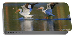 Portable Battery Charger featuring the photograph White Pelican Landing by John F Tsumas
