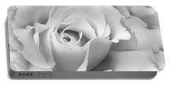Portable Battery Charger featuring the photograph White Rose Ruffles Monochrome by Jennie Marie Schell