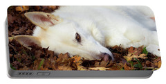 White Shepherd Rests In Autumn Leaves Portable Battery Charger