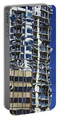 Portable Battery Charger featuring the photograph Wiggly Balconies by Phyllis Denton