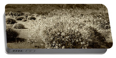 Portable Battery Charger featuring the photograph Wild Desert Flowers Blooming In Sepia Tone  by Randall Nyhof