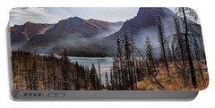 Portable Battery Charger featuring the photograph Wildfire Remnants Overlooking St. Mary's Lake, Glacier National Park by Lon Dittrick