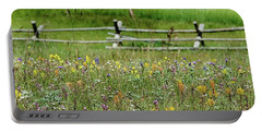Portable Battery Charger featuring the photograph Wildflower Fence by Gaelyn Olmsted