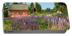 Wildflowers And Red Barn Portable Battery Charger by Roupen  Baker