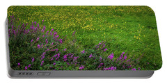 Portable Battery Charger featuring the photograph Wildflowers In An Irish Field by James Truett