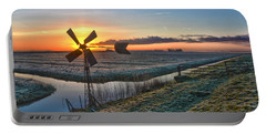 Windmill At Sunrise Portable Battery Charger by Frans Blok