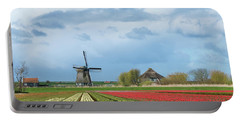 Portable Battery Charger featuring the photograph Windmill With Tulip Flower Fields In The Countryside by IPics Photography