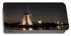 Windmills Illuminated At Night Portable Battery Charger