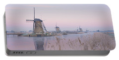 Windmills In The Netherlands In The Soft Sunrise Light In Winter Portable Battery Charger