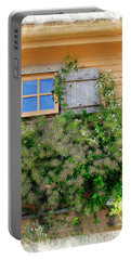 Portable Battery Charger featuring the photograph Window Floral In Plymouth by Joan  Minchak