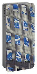 Portable Battery Charger featuring the photograph Windows Of 2 World Financial Center 3 by Sarah Loft