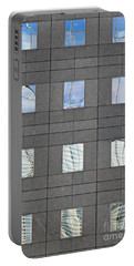 Portable Battery Charger featuring the photograph Windows Of 2 World Financial Center   by Sarah Loft