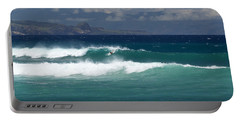 Portable Battery Charger featuring the photograph Windswept Ho'okipa by Susan Rissi Tregoning