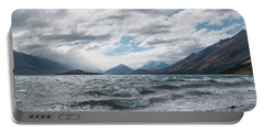 Portable Battery Charger featuring the photograph Windy Day On Lake Wakatipu by Gary Eason