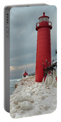 Portable Battery Charger featuring the photograph Winter At Grand Haven Lighthouse by Susan Rissi Tregoning