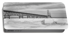 Portable Battery Charger featuring the photograph Winter At Mackinac Bridge by John McGraw