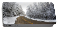 Portable Battery Charger featuring the photograph Winter Road by Todd Klassy
