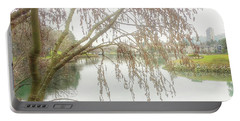 Portable Battery Charger featuring the photograph Winter's  End  by Connie Handscomb